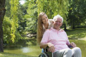 elderly-man-in-wheelchair-with-girl